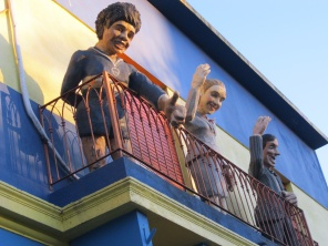 Maradona, Evita and Carlos Gardel wave to La Boca