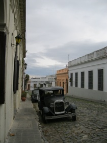 Looking down the street, Colonia (old car = seats for a restaurant)