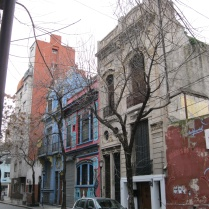 Carlos Gardel's street, with Buenos Aires painted houses nearby