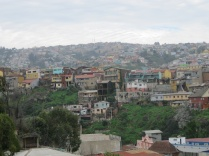 Some earthquake damage and very poor homes viewed from Cerro Alegre