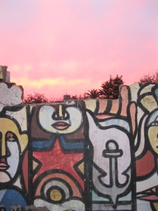 The graffitti on the front of the Bellavista wall with the sunset view