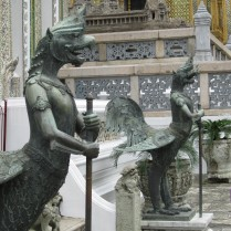 Guardian roosters with a model of Angkor Wat