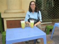 Sugar cane juice enjoyed on tiny chairs!