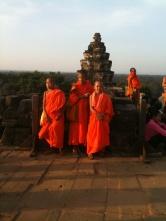Monks visiting the top of Phnom Bakheng